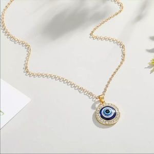 Gold tone round evil eye necklace 3/$30